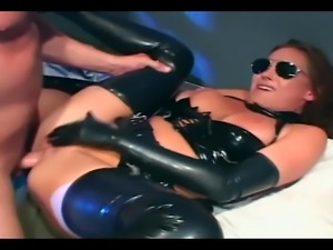 Busty babe in cop costume and latex gloves deepthroating and fucking
