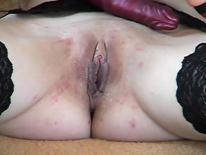 Watch this horny woman in stockings as she soaks herself, rubbing moist cunt...