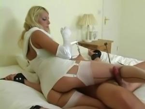Femdom in white lingerie teasing
