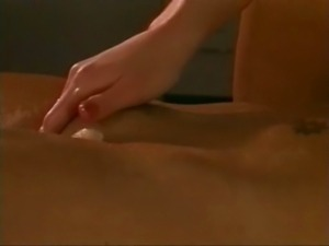 Terri and a girl giving each other massage.