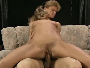 Busty hot blond mature fucking on the couch and trembling and moaning with...