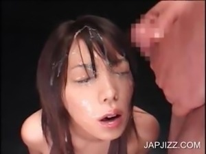 Asian girl getting facial jizzed