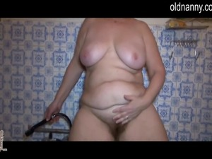 Granny masturbating in bathroom using shower