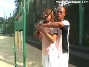 Sex on a tennis court while pretending to practice swinging and they are...