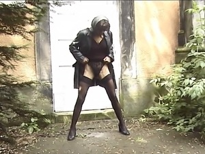Mysterious brunette MILF dressed in black pissing in a park hoping not to be...