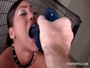 Diaperd chained ebony sucks big dildo