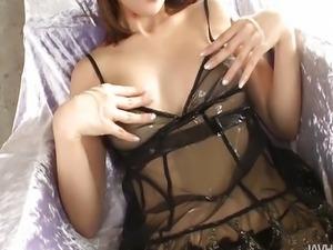 Riona Suzune is oiled up while she masturbates