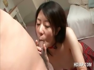 Topless asian hot bitch giving blowjob and titjob