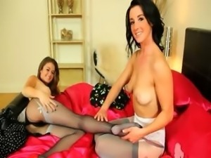 Two brunette lesbs teasing in nylons