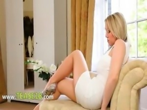 Beautiful blondie bride teasing on sofa