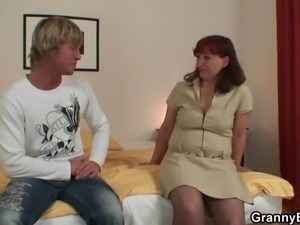 Red head oldie has lured inside porn