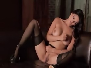 blackhair with big tits on brown sofa