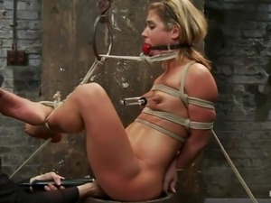 tied up blonde taking her punishment