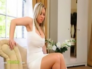 sleek blonde bride teasing on sofa