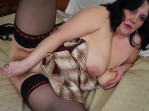 brunette mature bitch playing with her favorite sex toy