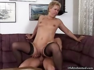 Mature  in sexy stockings riding