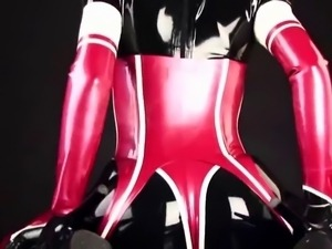 Black latex catsuit & red corset