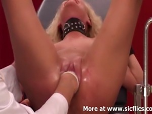 Submissive amateur slave is strapped to a gyno chair and fist fucked in her...
