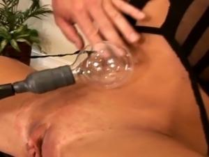 Toturing her HUGE clit!
