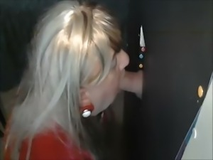 TRANNY SUCKING LARGE COCK AT GLORYHOLE
