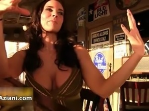 Busty brunette babe gets horny showing