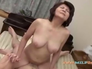 Busty Mature Woman Sucking Guy Getting Her Shaved Pussy Fucked On The Bed In...