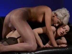 Horny brunette sucking dick of rubber