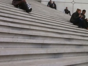 Sexy woman in black pantyhose sit on stairs