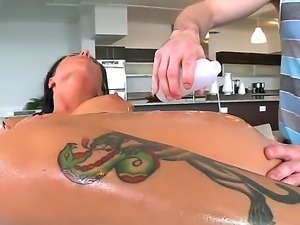 Nasty babe Christy Mack gets a hot massage and demonstrates her sweet oiled body