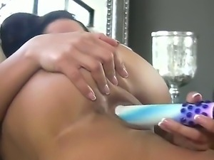 Gorgeous Angel Dark makes her dildo wet and introduces it in her tight pussy