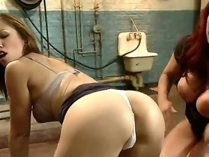 Dirty lesbian whores Kelly Divine and Audrey Rose are tortured in the hellish...