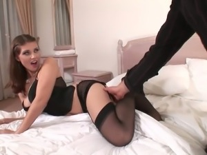 Naturally buxom brunette Simi dressed in black gets her massive