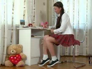 Sweet dark haired girl Zoya poses in lovely schoolgirl uniform