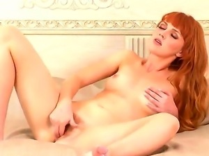 Marvelous skinny redhead Marie McCray is rubbing her wet vagina on camera