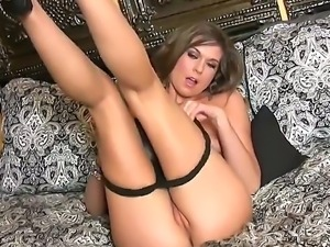 Adorable glamorous brunette Adrienne Manning with natural boobs in high heels...