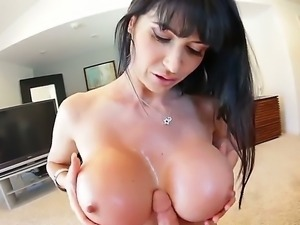 Mature brunette oiled her huge fake boobs and gave titfuck to her lovers dick