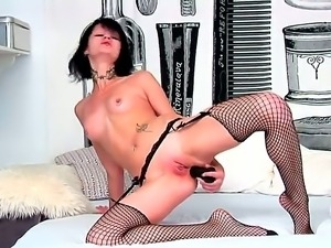 Wild black haired slut Nova Black doesnt need dick to pound her asshole hard