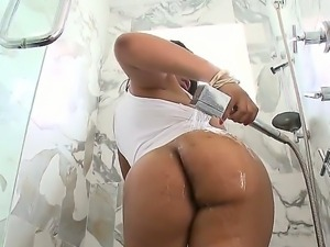 Busty ebony bitch Aryana Adin performs exclusive wet strip show in the shower!