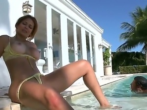 Busty hottie Monique Fuentes enjoys posing with her big ass and tits in...