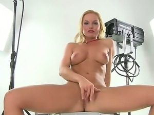 Hot and sexy blonde Silvia Saint naughtily posing naked to the camera, she...