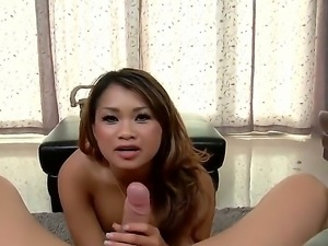 Naughty Asian slut, Annie Lee, demonstrates big delicious boobs and rides on...