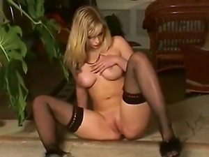 The hot Marry Queen with a big boobs and black stockings penetrates her...