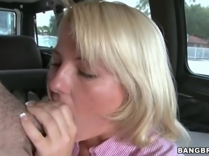 Elegant blonde Casey Cumz in pink blouse and gray skirt