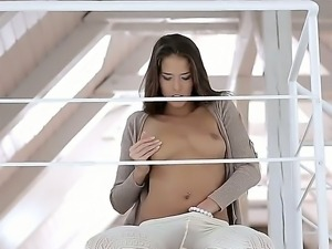 Beautiful cutie Silvie strips,shows her cute pussy and erotically pleases her...