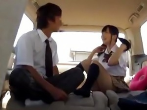 Horny Japanese schoolgirl has sex in a car