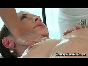 Sexy brunette is massaged by lesbian