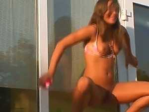 A very sexy teen slut undressed outdoors and is going to use a dildo for her...