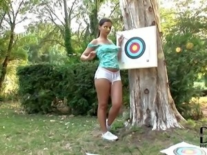 Eve Angel is a super hot babe who love archery.