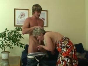 Granny seduces a young muscular stud