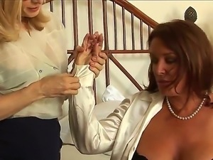 Two so beautiful and attractive busty milfs lesbians Nina Hartley and Rachel...